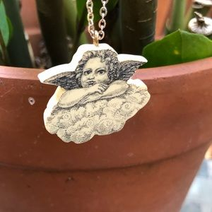 K.McClellan resin scrimshaw necklace.